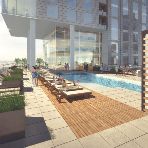 People Enjoying the Rooftop Pool at The Residences at Omni Louisville Apartments