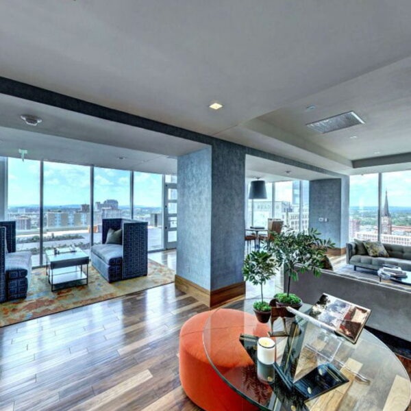 Apartments in Louisville KY - Spacious Clubhouse Featuring Plenty of Lounge Areas and Large Windows Showing Views of the City