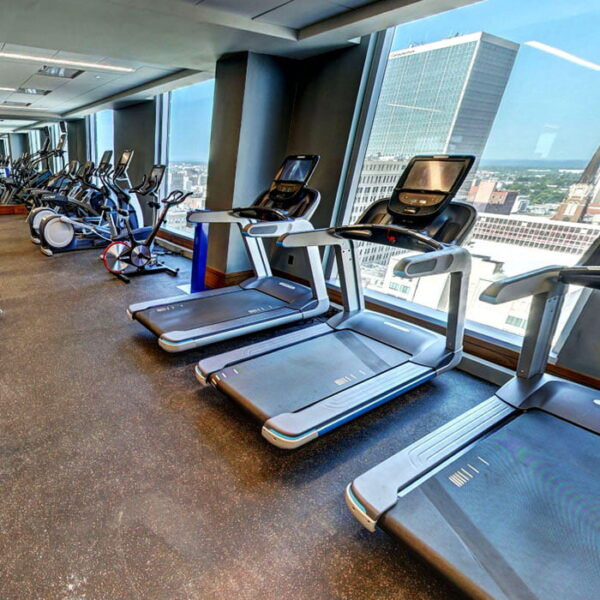 Louisville KY Apartments - Spacious Fitness Room Featuring Various Gym Equipment
