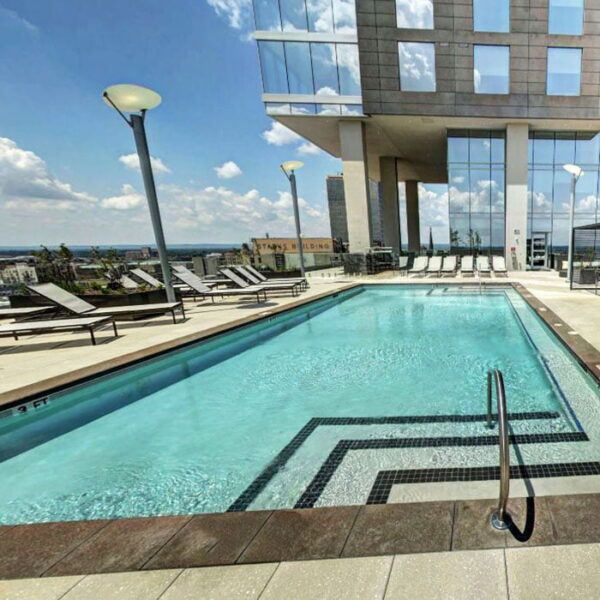 Apartments for Rent in Louisville KY - Rooftop Swimming Pool Featuring Various Lounging Areas
